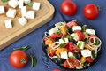 Salad with tomatoes, feta chees, apricots Stock Photo