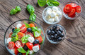 Salad with tomatoes, olives, mozzarella and basil Royalty Free Stock Photo
