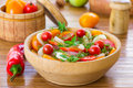 Salad with tomatoes and squid fresh in a wooden plate Royalty Free Stock Image