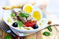 Salad with tuna and boiled eggs fresh tomatoes olives italian recipe Stock Photo