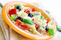 Salad with tuna pasta and tomatoes fresh farfalle olives italian kitchen recipe Royalty Free Stock Image