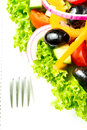 Salad with vegetables and greens in plate on table cloth macro tablecloth Royalty Free Stock Images