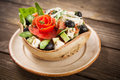Salad with vegetables and greens on wooden table Royalty Free Stock Image