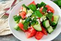 Salad with watermelon, mint, cucumber and feta, close up Royalty Free Stock Photo