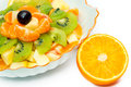 Salade de fruits dans le vase et l orange Image libre de droits