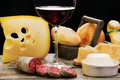 Salami, dairy products and red wine Stock Image