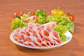 Salami and fresh vegetables Stock Image
