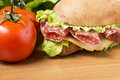 Salami sandwich with lettuce cheese and tomatoes Royalty Free Stock Images