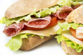 Salami sandwich with lettuce cheese and tomatoes Royalty Free Stock Image