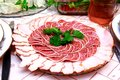 Salami slices on the table Stock Photo