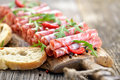 Salami snack air dried italian from tuscany served on a wooden board with ciabatta bread Stock Photography