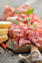 Salami snack air dried italian from tuscany served on a wooden cutting board with ciabatta bread Stock Photos