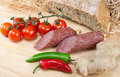 Salami with spices and tomatoes Royalty Free Stock Photos