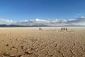 Salar Uyuni dirty salt lake and tourists on sunset Royalty Free Stock Photo