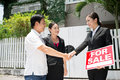 Sale agreement image of new owners coming to an with a realtor Stock Photo