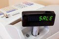 SALE on a cash register display Royalty Free Stock Photo