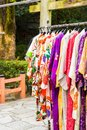 Sale of colorful kimonos on the city street in Kyoto, Japan. Vertical. Royalty Free Stock Photo