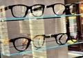 Sale of eyeglass frames are glass desk Stock Photos