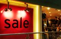 Sale fashion apparel shop a photograph showing the large word in the window of a fashionable inside a modern shopping centre Stock Images