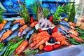 Sale of fresh frozen arranged fish on ice in farmer`s bazaar. Op Royalty Free Stock Photo