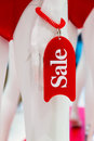 Sale - the inscription on plate on the arm of the dummy in the store Royalty Free Stock Photo