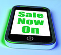Sale now on phone shows promotional savings showing or discounts Stock Photos