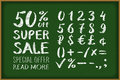 Sale 50 percent drawing on blackboard. Numbers 0-9 written with a brush on a black background lettering. Super Sale. Big sale. Sal
