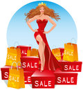 Sale Queen. Beautiful woman in a long red evening dress stands on a large number of boxes with purchases Royalty Free Stock Photo