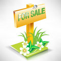 For sale real estate plate sign on land Stock Photo