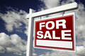 For Sale Real Estate Sign on Cloudy Sky Stock Photo