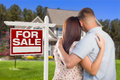 For sale real estate sign military couple looking at house and affectionate nice new Royalty Free Stock Photo
