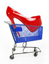 Sale shoes concept, red shoes in blue shopping car Stock Images