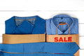 Sale with shoes and shirts Royalty Free Stock Photo