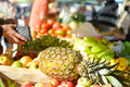 Sale shopping consumerism and pineapple in concept with fruits on grocery market stall background Royalty Free Stock Photo