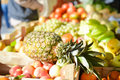 Sale shopping consumerism and pineapple in grocery market concept with fruits on stall background Royalty Free Stock Image