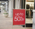 Sale sign outside retail store in fashion mall Royalty Free Stock Photo