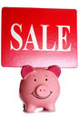 Sale sign and piggybank Stock Photos