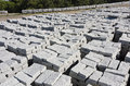 For sale small granite blocks stacked on pallets ready Royalty Free Stock Photo