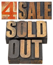 For sale and sold out business concept isolated text in vintage letterpress wood type Stock Photography