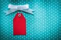 Sale tag on blue polka-dot tablecloth