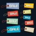 Sale tags labels set with strings on dark background Stock Images