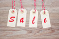 Sale tags set of four on wooden background Stock Images