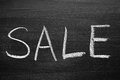 Sale title written with a chalk on the blackboard Royalty Free Stock Photography