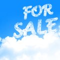 For sale white clouds in a clear blue sky with written in it Stock Photography