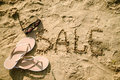 Sale written in the sand on a beach Royalty Free Stock Photo