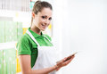 Sales clerk with tablet young female working digital at supermarket Royalty Free Stock Photos
