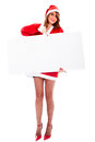 Sales concept sexy young santa claus woman holding white customizable billboard Royalty Free Stock Image