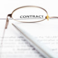 Sales contract through eyeglasses Royalty Free Stock Photo