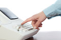 Sales person entering amount on cash register in retail store Royalty Free Stock Photo