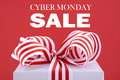 Sales promotion gift box cyber monday red and white closeup against a red background with sample text Royalty Free Stock Image